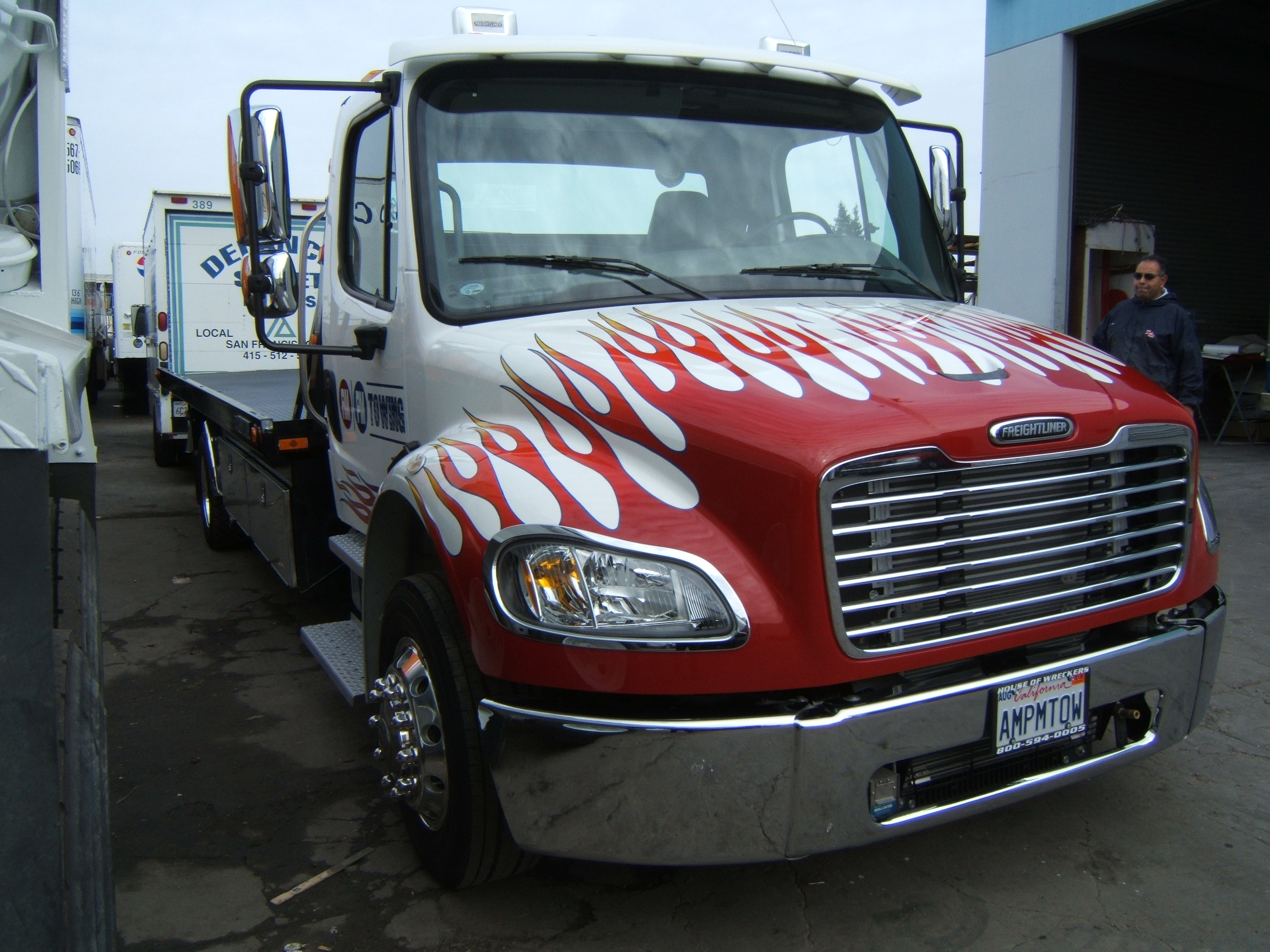 Tow truck with custom painted flames & vinyl letters.