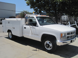 Utility truck refinished with commercial fleet coatings.